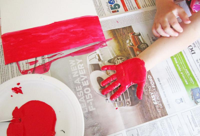 Paint your child's hand red.
