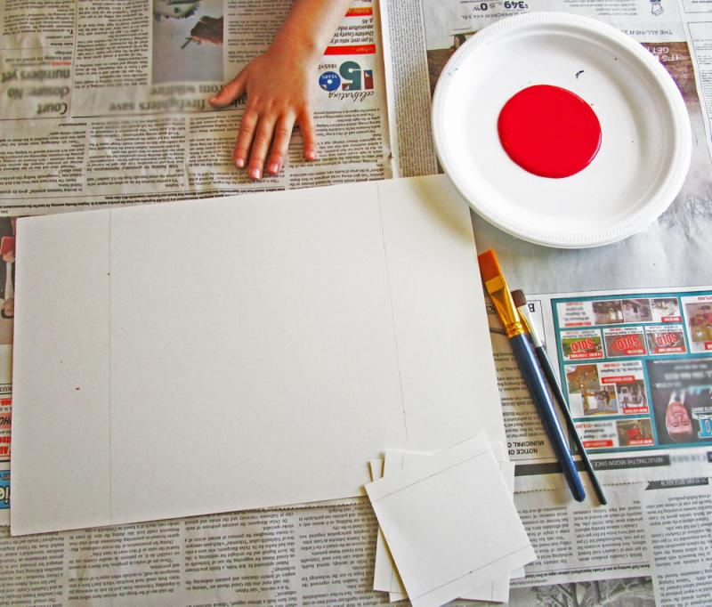 Gather your supplies to make handprint Canada flags.