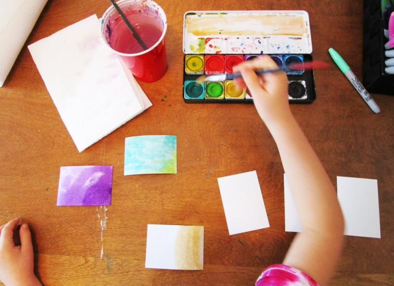 Use watercolour paints and markers to decorate artist trading cards.