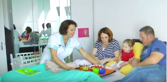 Ducth maternity nurses feed new mothers breakfast in bed.