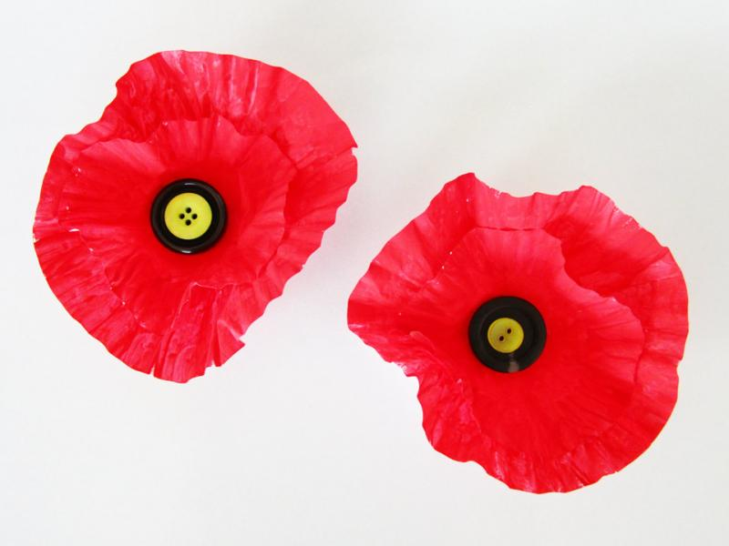 Craft poppies with muffin liners, paint and buttons.