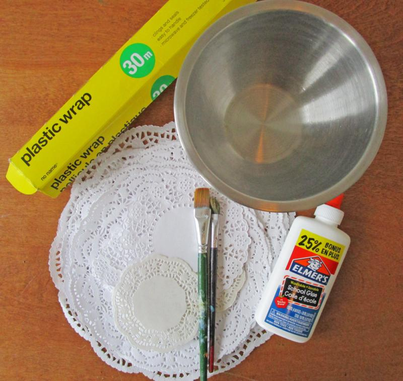 What you need to make a paper doily bowl.