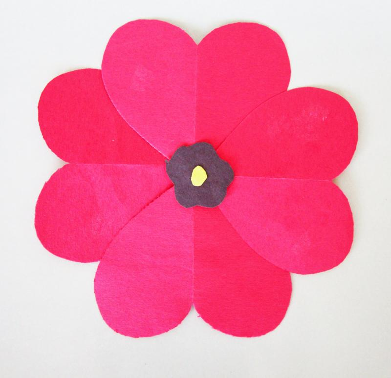 This poppy was made using construction paper.