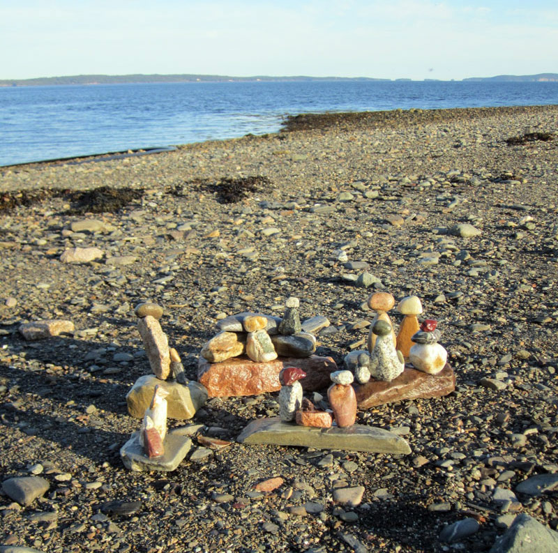 Kids can make sculptures with stones at the beach.