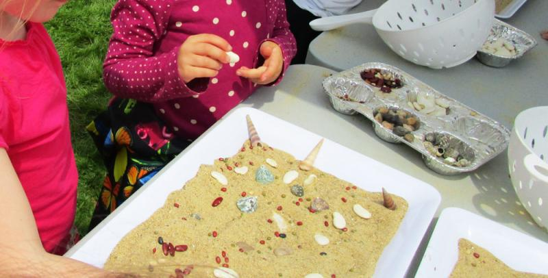 Kids can make temporary mosaics with sand.