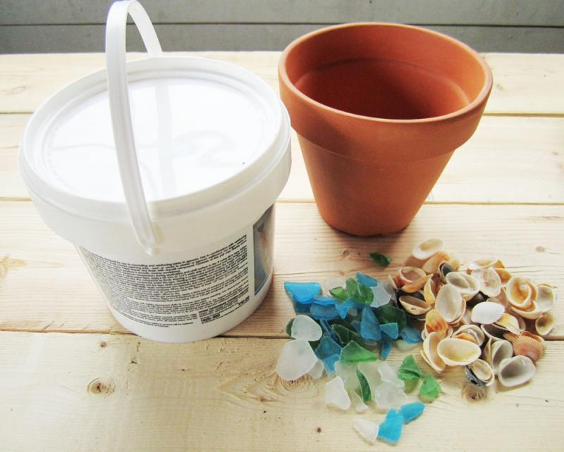 Gather drywall compound, a terracotta pot and some odds and sods (beach glass, seashells, etc.)