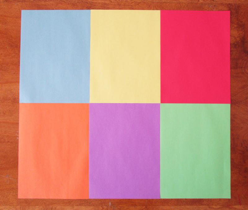 Arrange six sheets of construction paper together.