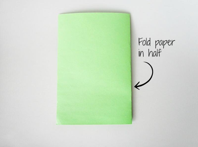 Fold the construction paper in half.